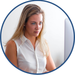 Female Financial Controller with blonde hair and white blouse using OEE to view quality data