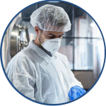 Male Quality Analyst with white hair net and mask increasing operational efficiency